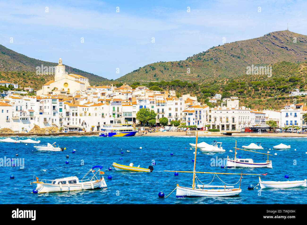 Fishing boats on sea in Cadaques white village, Costa Brava, Spain Stock Photo