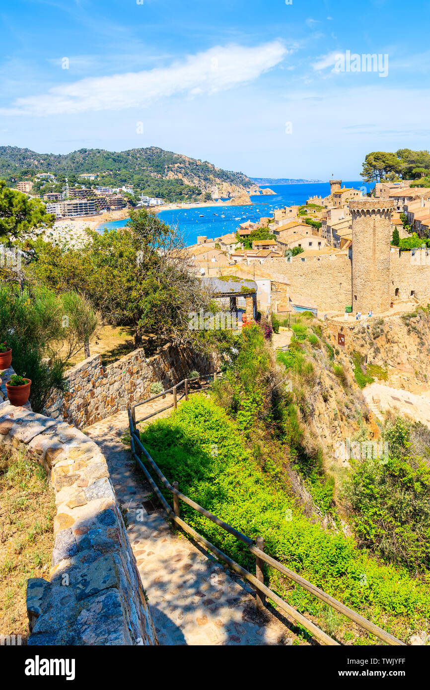Coastal path and sandy beach with bay in Tossa de Mar town, Costa Brava, Spain Stock Photo