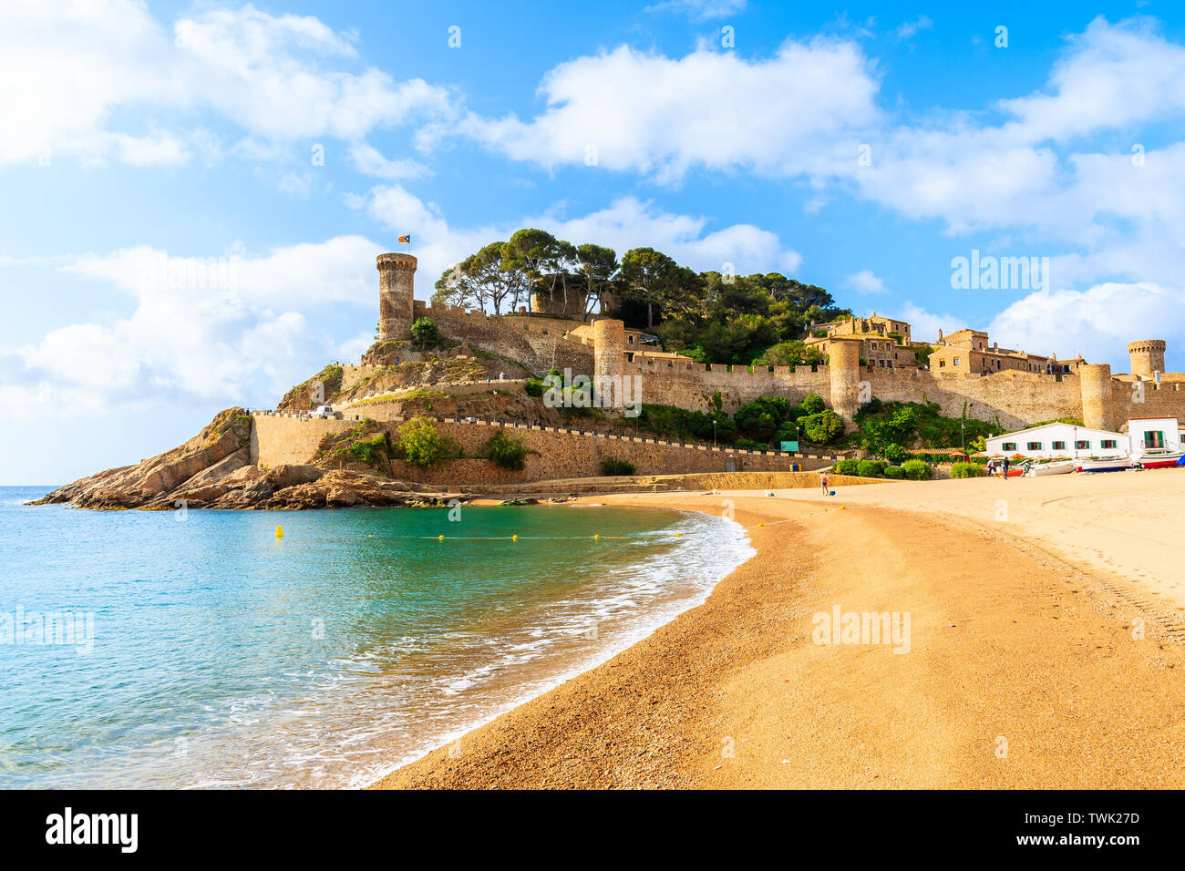 Golden sand beach in bay with castle in Tossa de Mar, Costa Brava, Spain Stock Photo