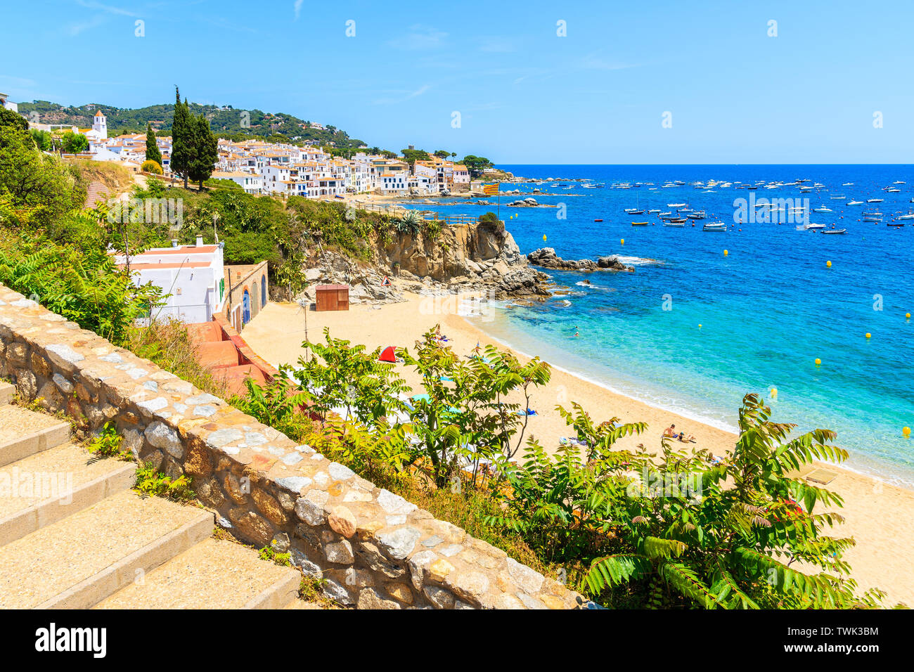 Steps to beach in Calella de Palafrugell, scenic fishing village with white houses and sandy beach with clear blue water, Costa Brava, Catalonia, Spai Stock Photo