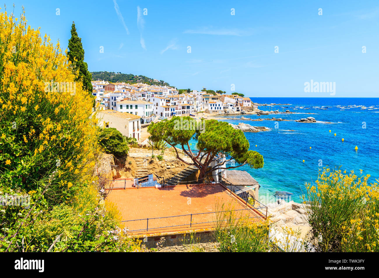 Amazing view of Calella de Palafrugell, scenic fishing village with white houses and sandy beach with clear blue water, Costa Brava, Catalonia, Spain Stock Photo