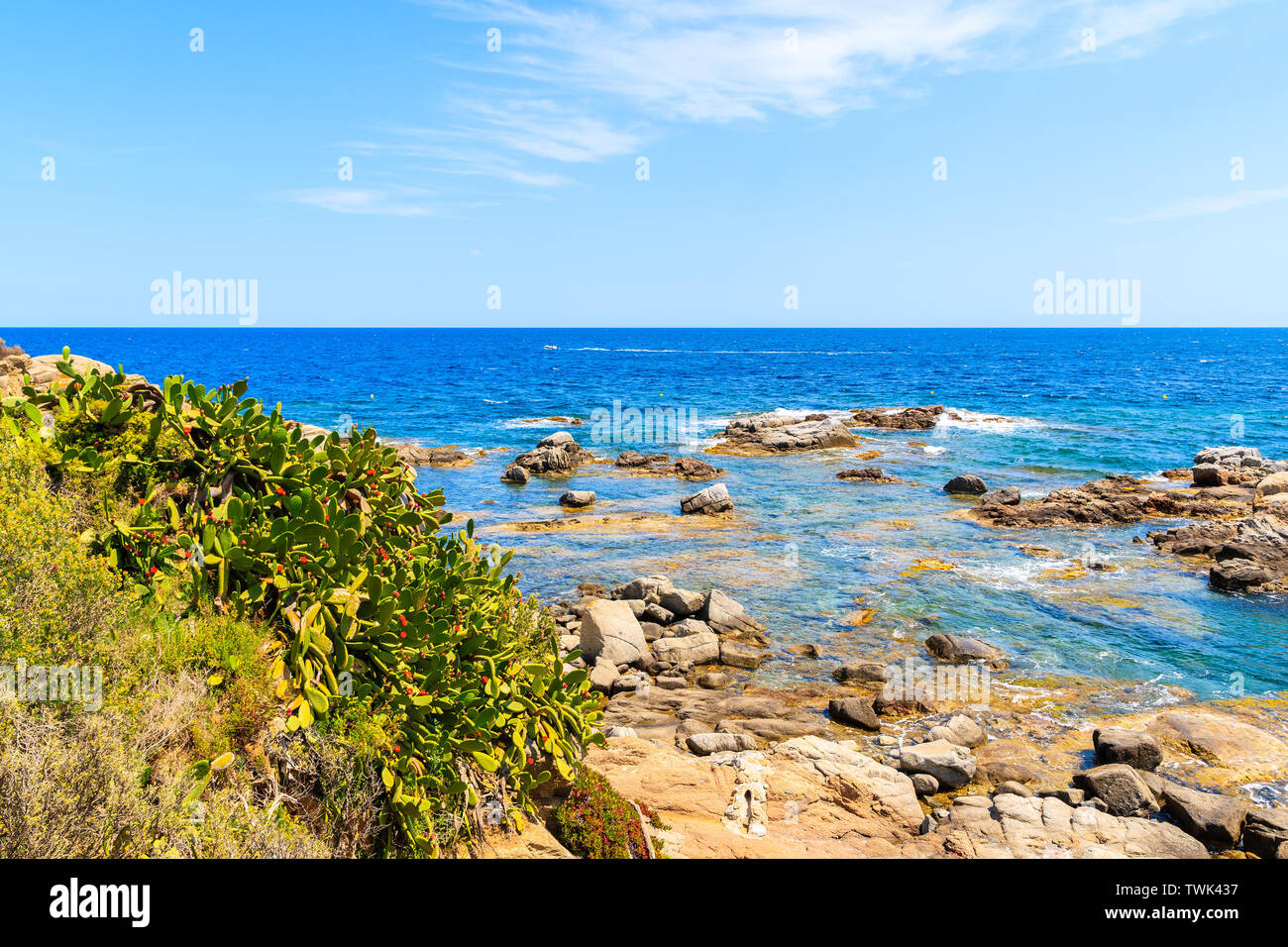 Beautiful bay with boats on sea and view of Llafranc village, Costa Brava, Spain Stock Photo