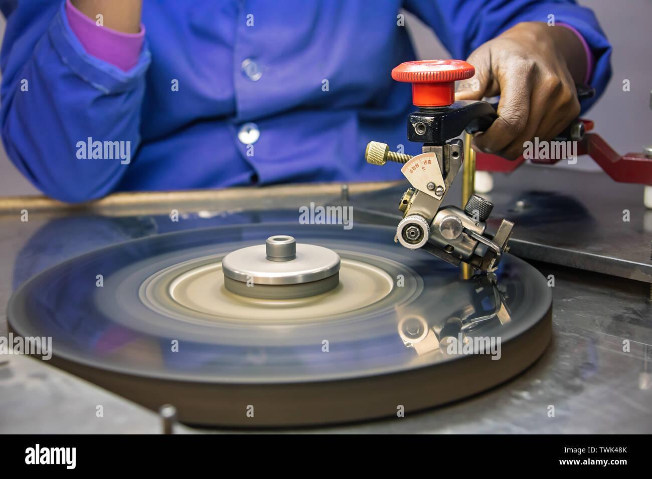 Machines to polish diamonds, grading diamonds, african woman working. In Africa , Botswana - Stock Image