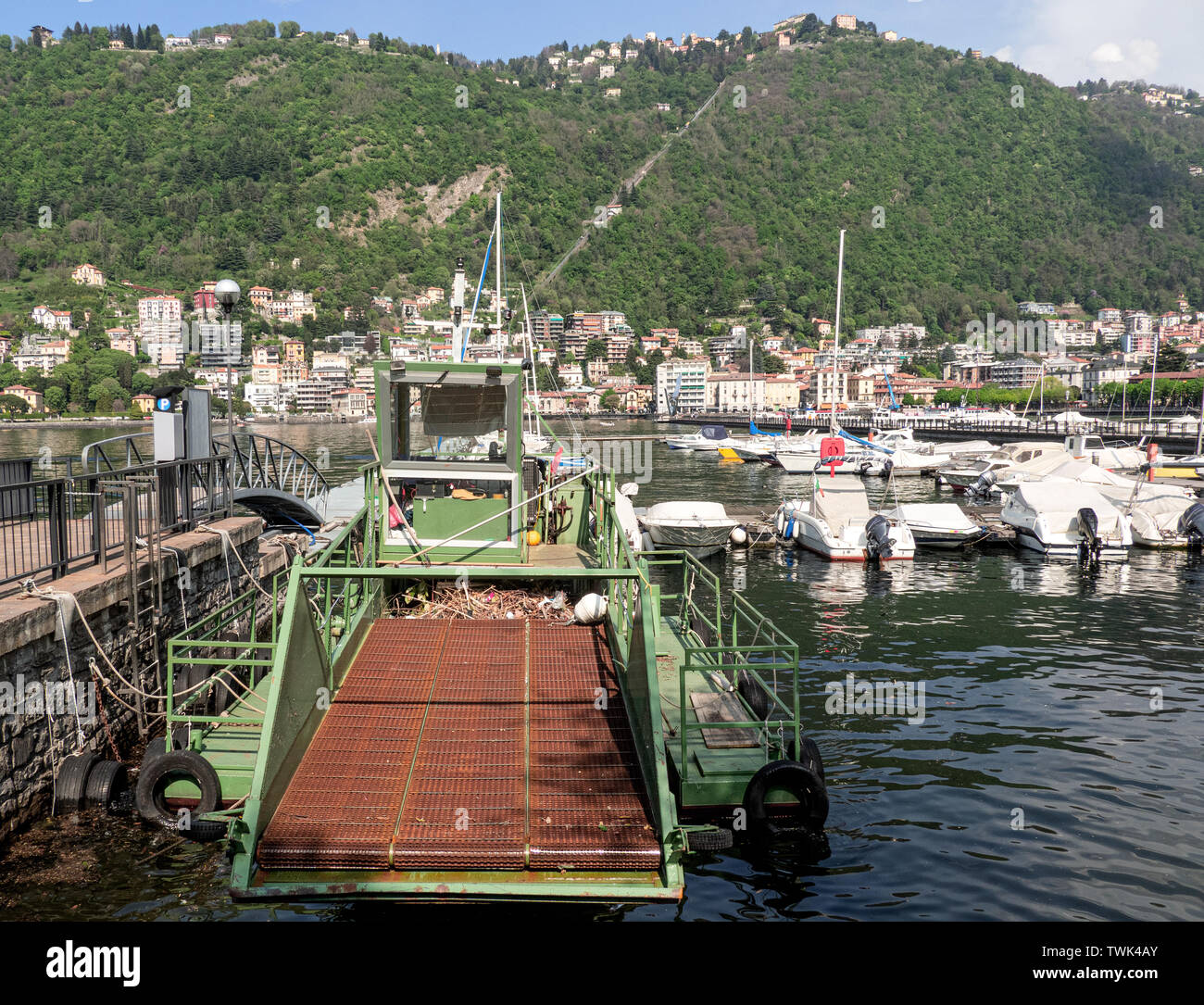 Como Lake - Italy. naval vehicle for water cleaning and waste collection, moored in the port of Como - Stock Image
