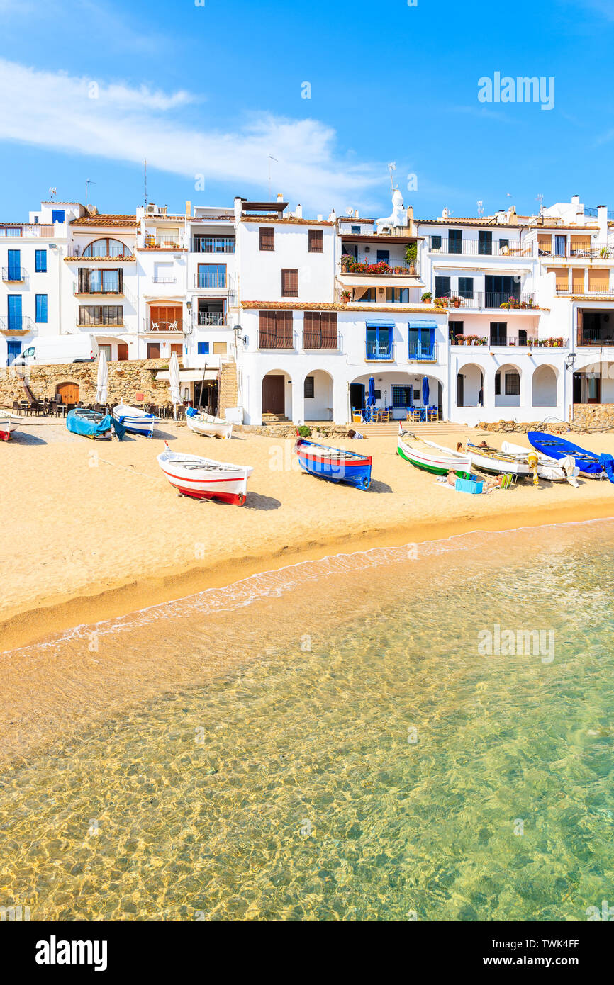 Traditional fishing boats on beach in Calella de Palafrugell, scenic village with white houses and sandy beach with clear blue water, Costa Brava, Cat Stock Photo