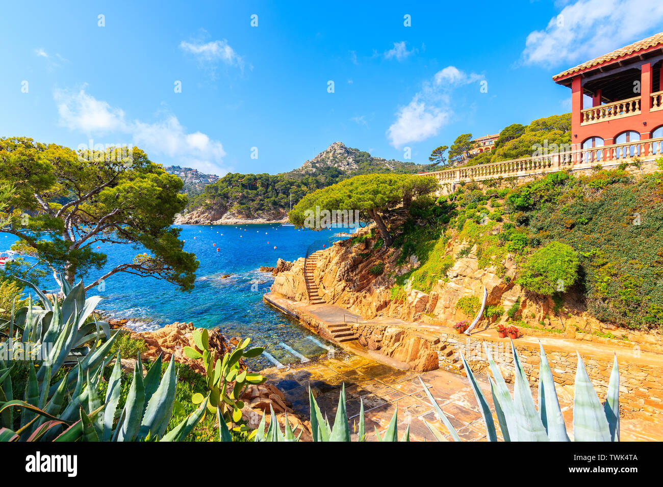 View of coastal path and sea in picturesque port of Fornells village, Costa Brava, Spain Stock Photo