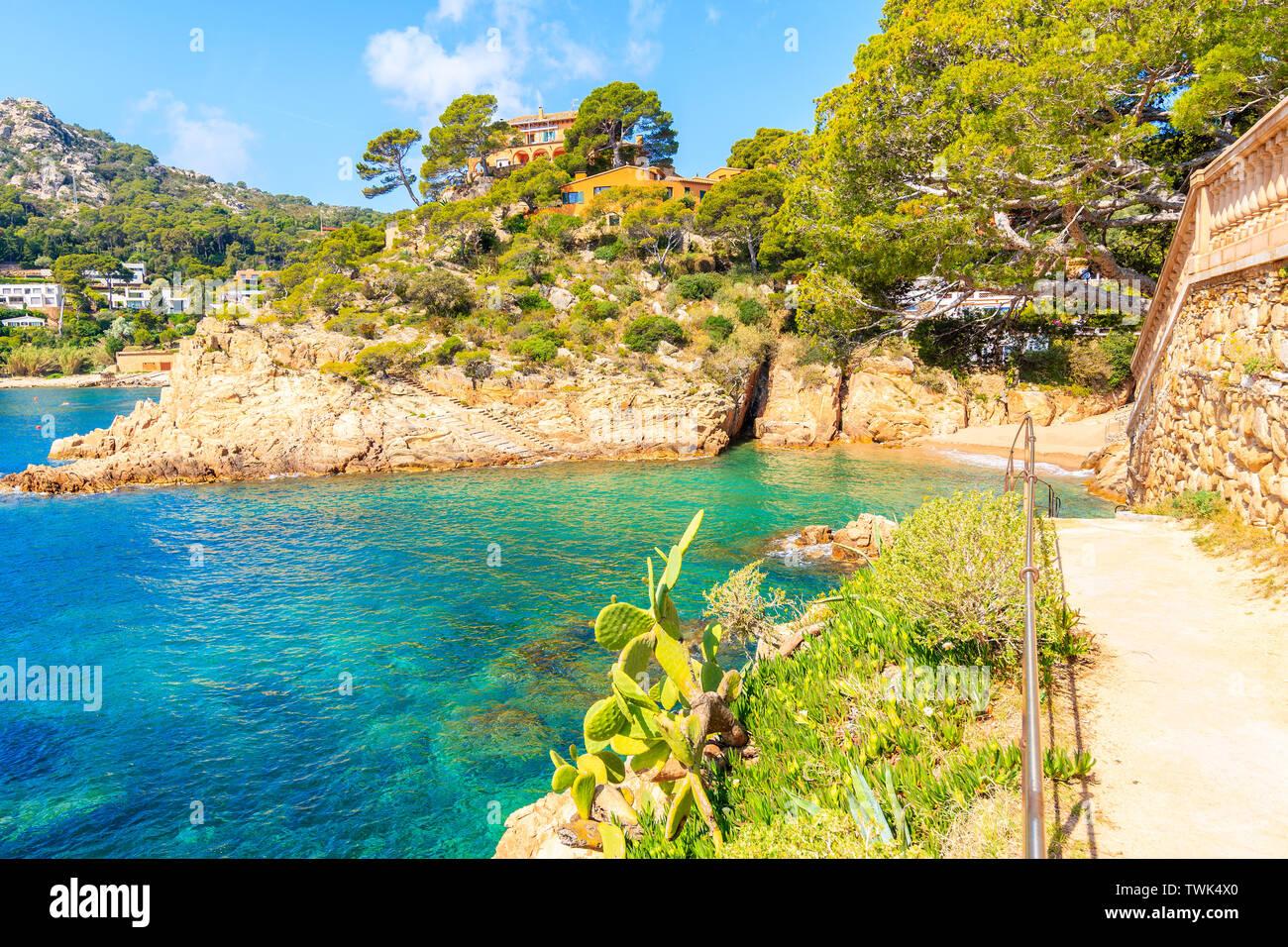 Coastal path along sea in picturesque Fornells village, Costa Brava, Spain Stock Photo