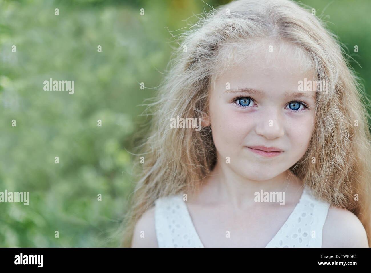 Close Up Portrait Of Beautiful Little Girl With Blonde Long Hair