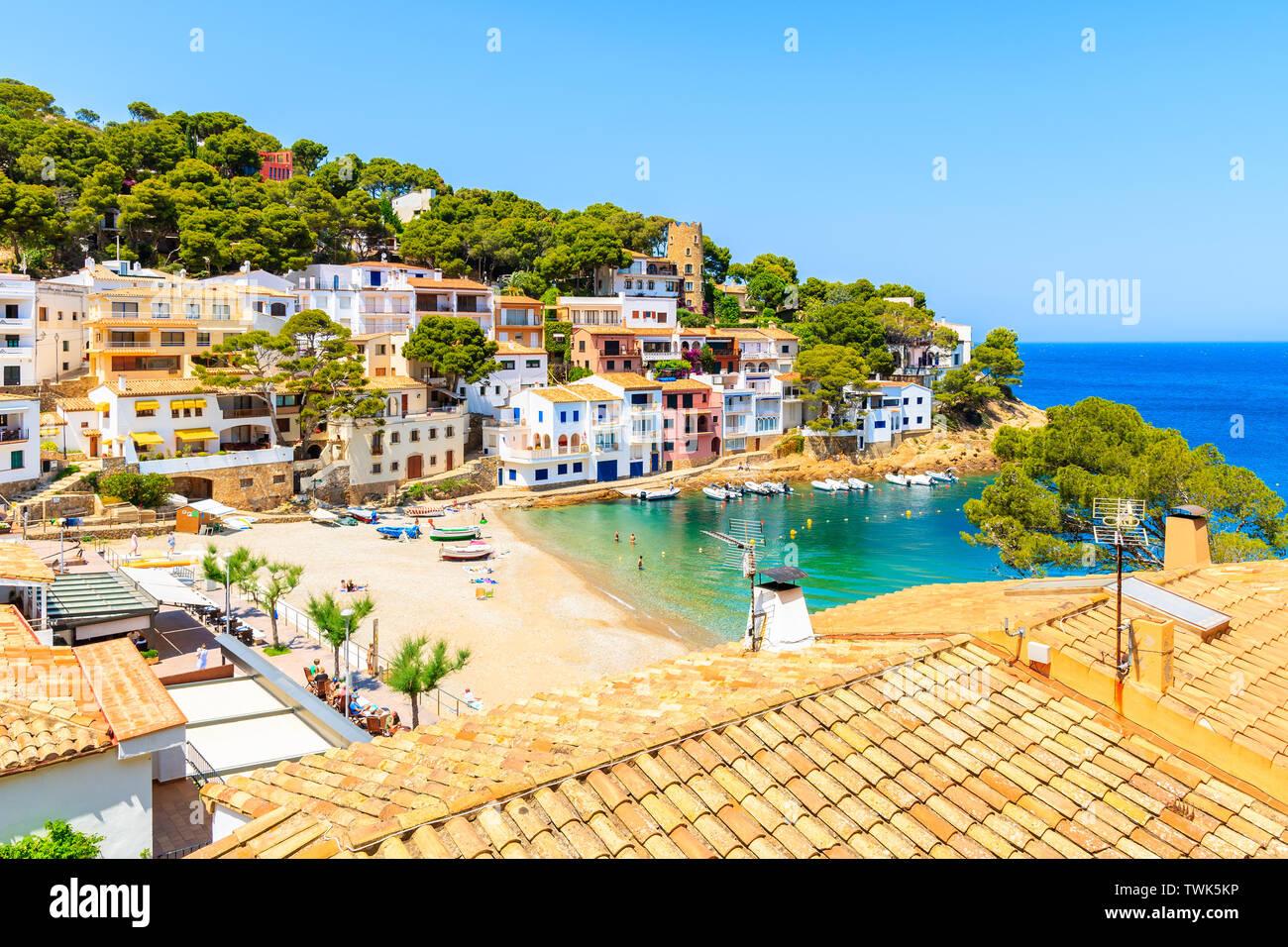 View of colorful houses in sea bay with beach in Sa Tuna coastal village, Costa Brava, Spain Stock Photo