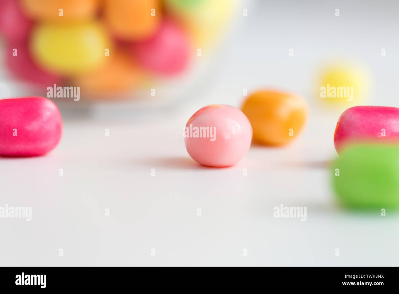 close up of candy drops over white background - Stock Image