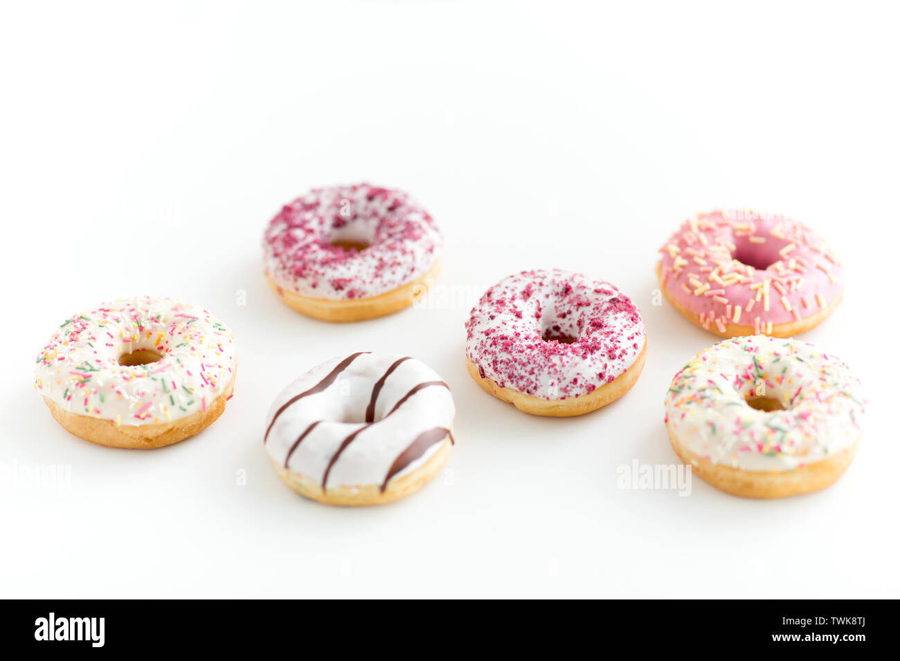 close up of glazed donuts on white table - Stock Image