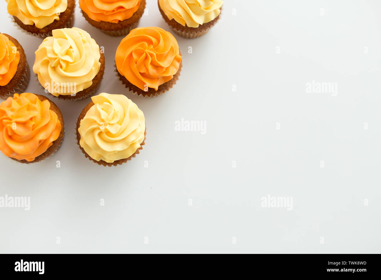 cupcakes with frosting on white background - Stock Image