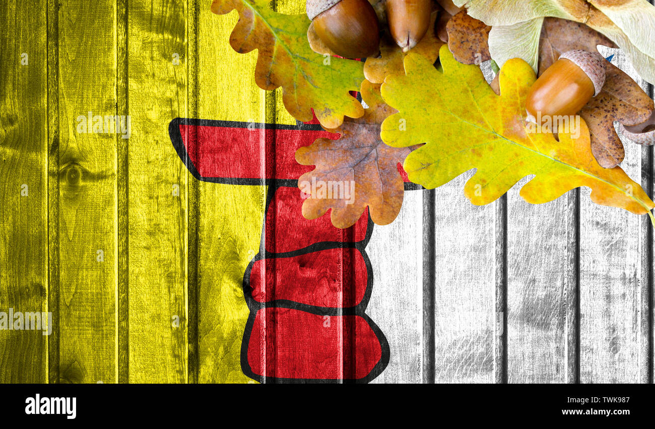 Nunavut flag on autumn wooden background with leaves and good place for your text. - Stock Image