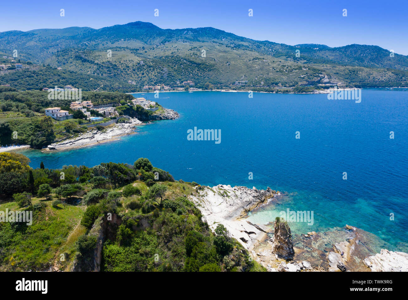 Aerial view of Cassiopi beach,beautiful bay and deep blue sea with mountains in the background - Stock Image
