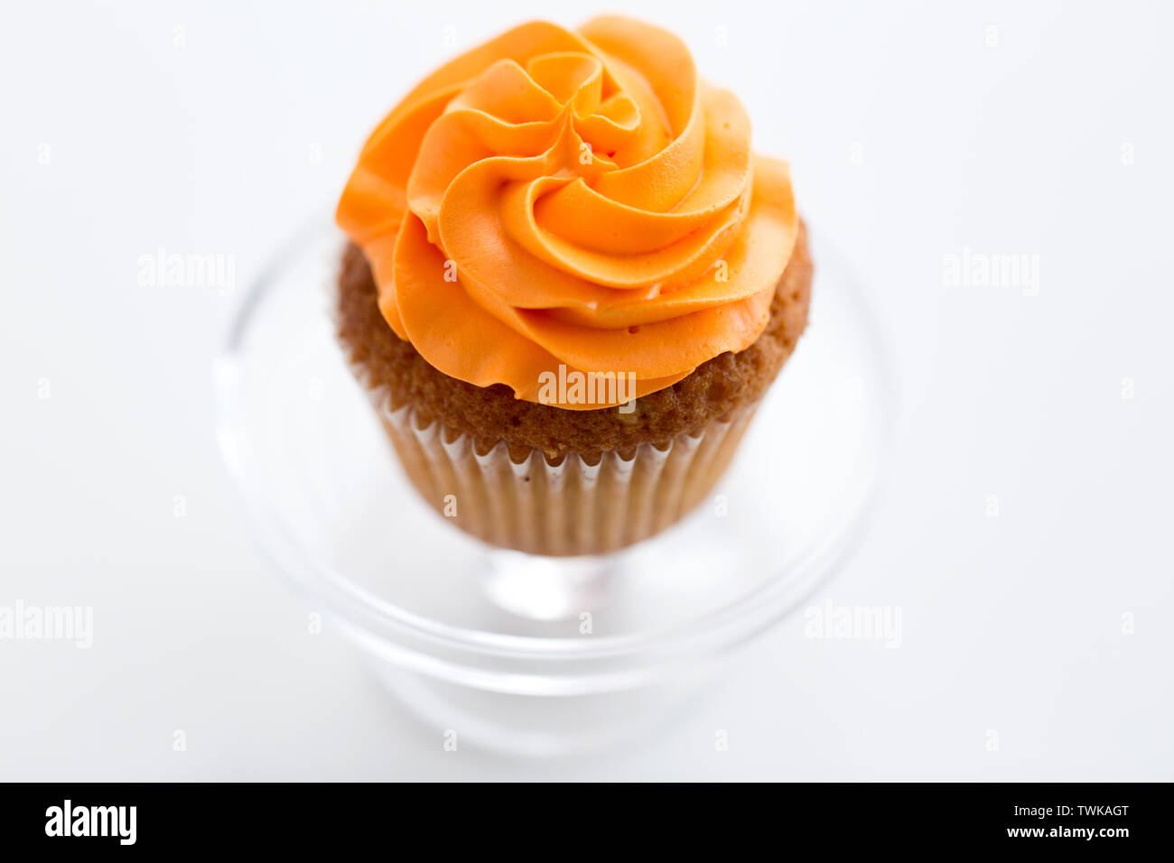 cupcake with frosting on confectionery stand - Stock Image