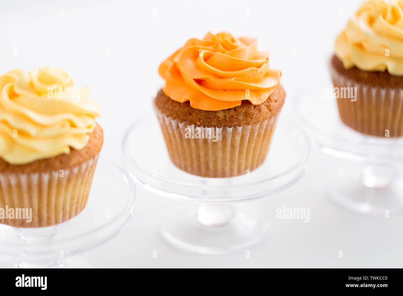cupcakes with frosting on confectionery stands - Stock Image