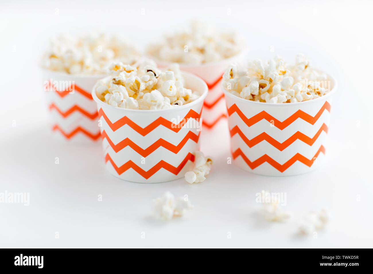 close up of popcorn in disposable paper cups - Stock Image