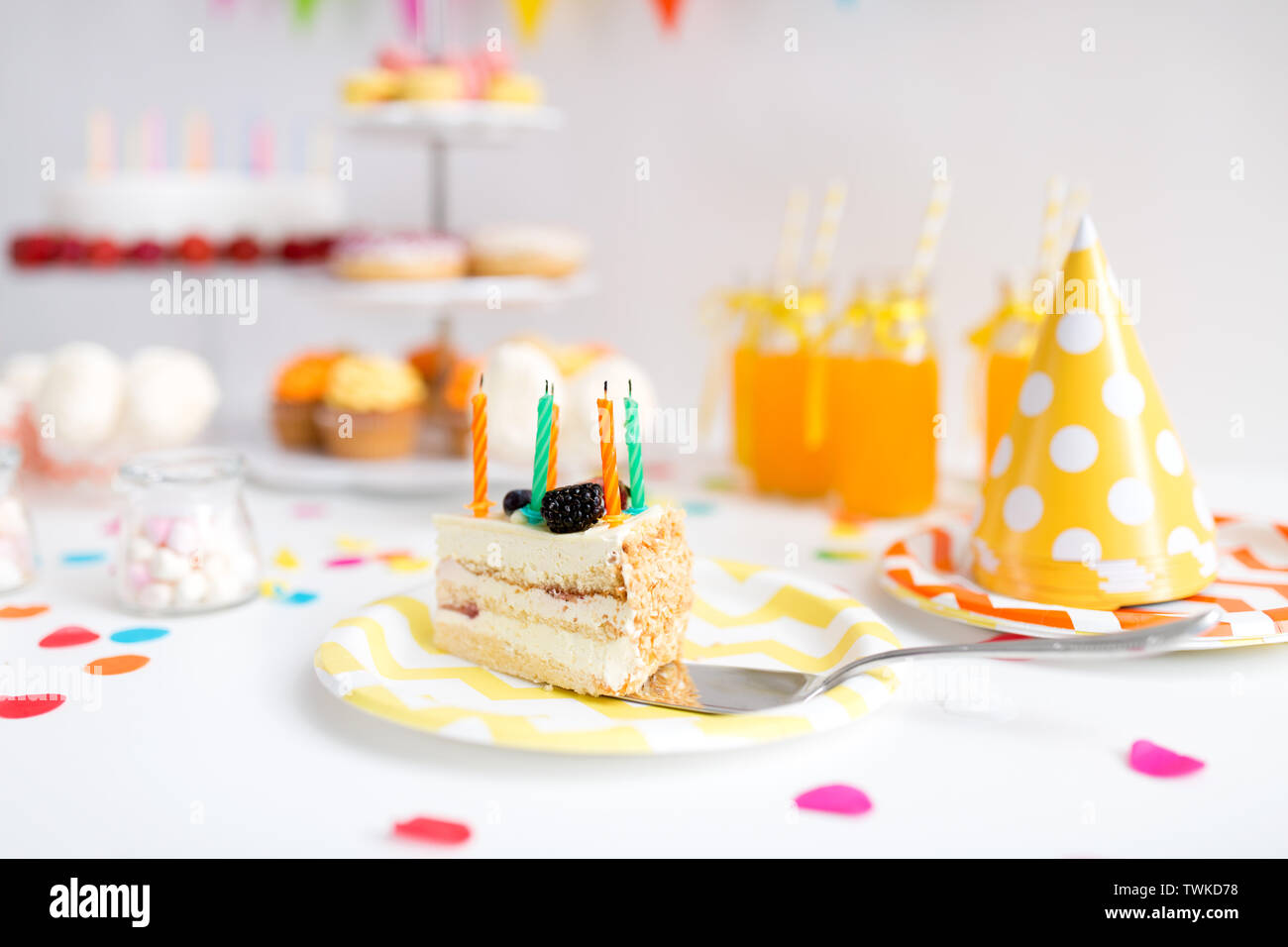 piece of cake on plate at birthday party - Stock Image