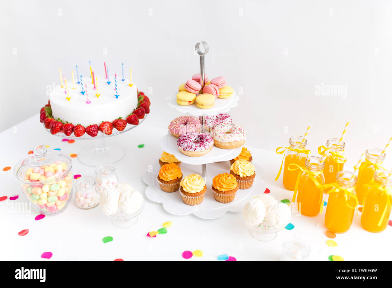 food and drinks on table at birthday party - Stock Image
