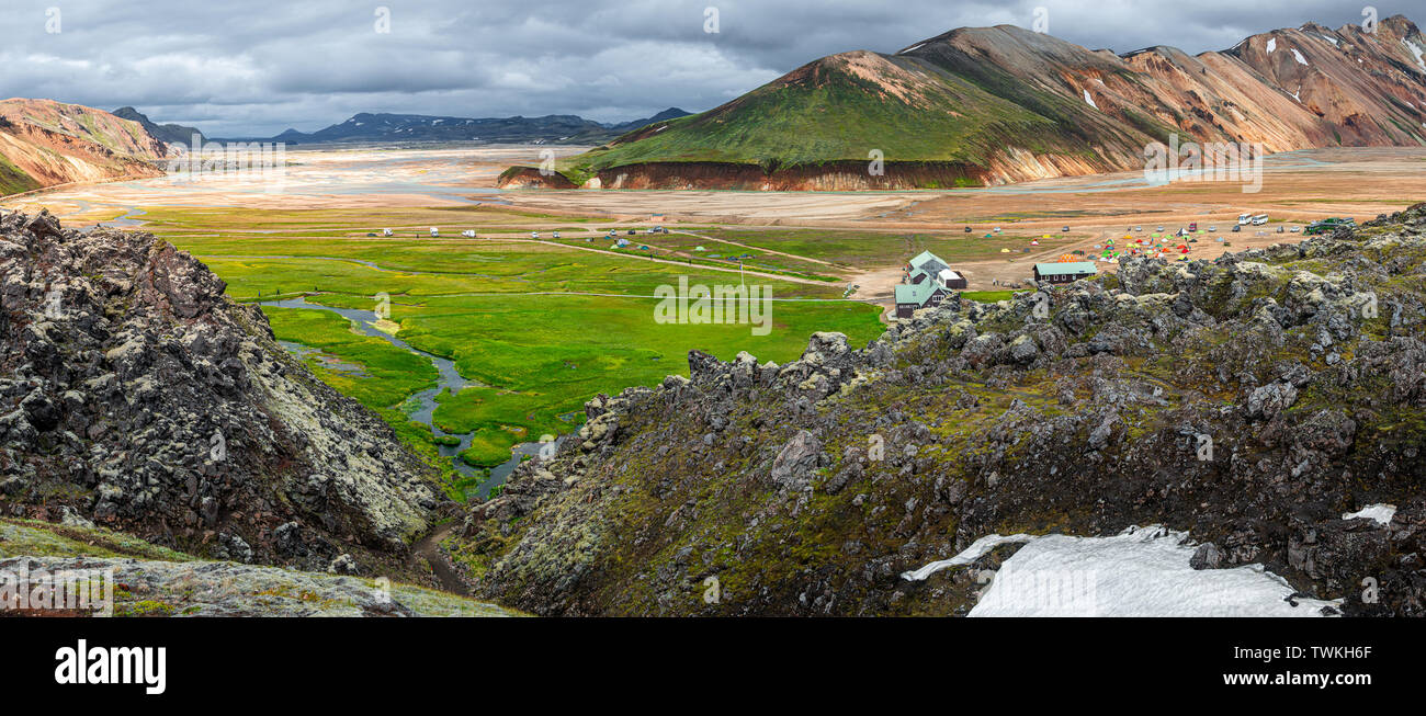 Panoramic view of colorful volcanic Landmannalaugar region and camping site in Iceland, summer time, dramatic scene - Stock Image