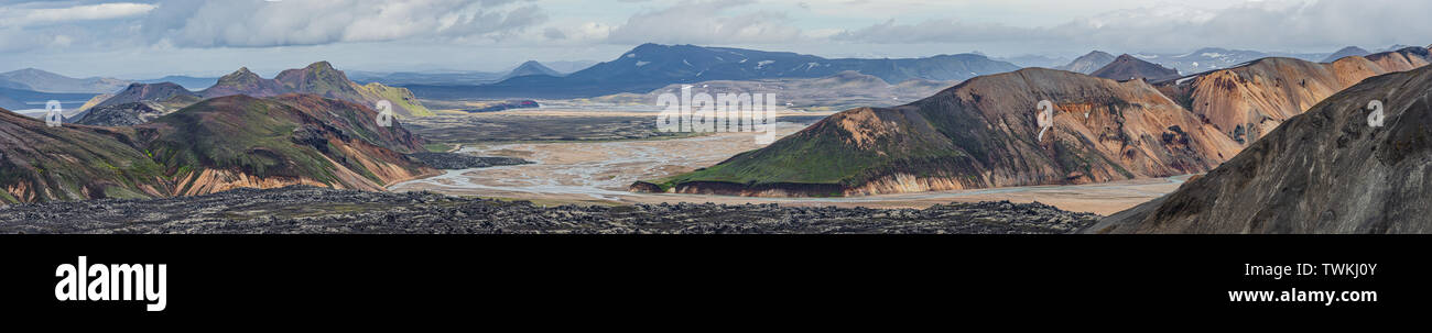 Panoramic view of colorful volcanic Landmannalaugar region and lava field called Laugahraun in Iceland, summer time, dramatic scene - Stock Image