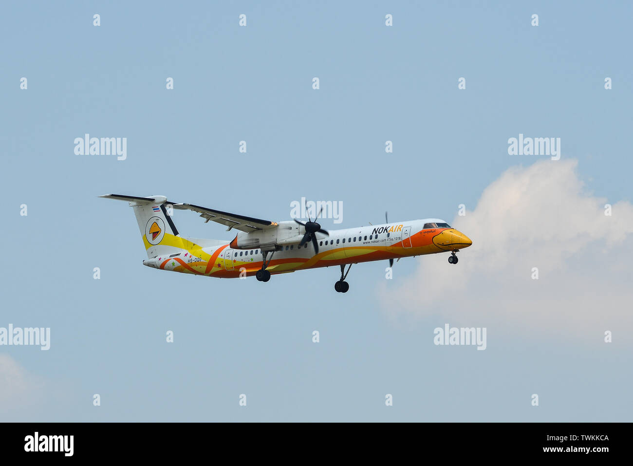 Bangkok, Thailand - Apr 24, 2018. HS-DQG Nok Air De Havilland Canada Dash 8-400 landing at Don Muang Airport (DMK) in Bangkok, Thailand. - Stock Image