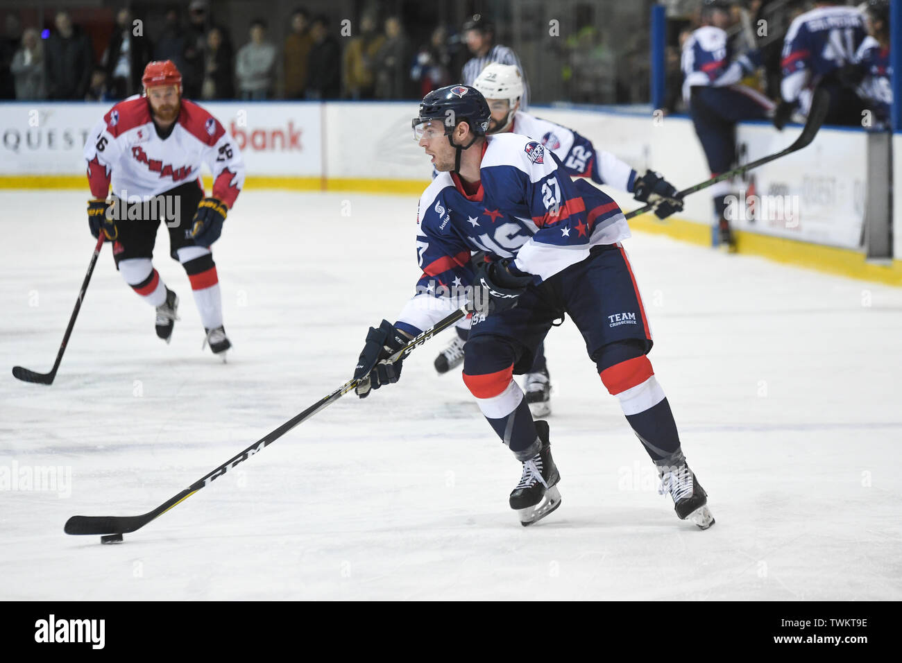 Melbourne, Australia. 21st June 2019, O'Brien Group Arena, Melbourne, Victoria, Australia; 2019 Ice Hockey Classic, Canada versus USA; Tim Harrison of USA moves the puck forward Credit: Action Plus Sports Images/Alamy Live News Stock Photo
