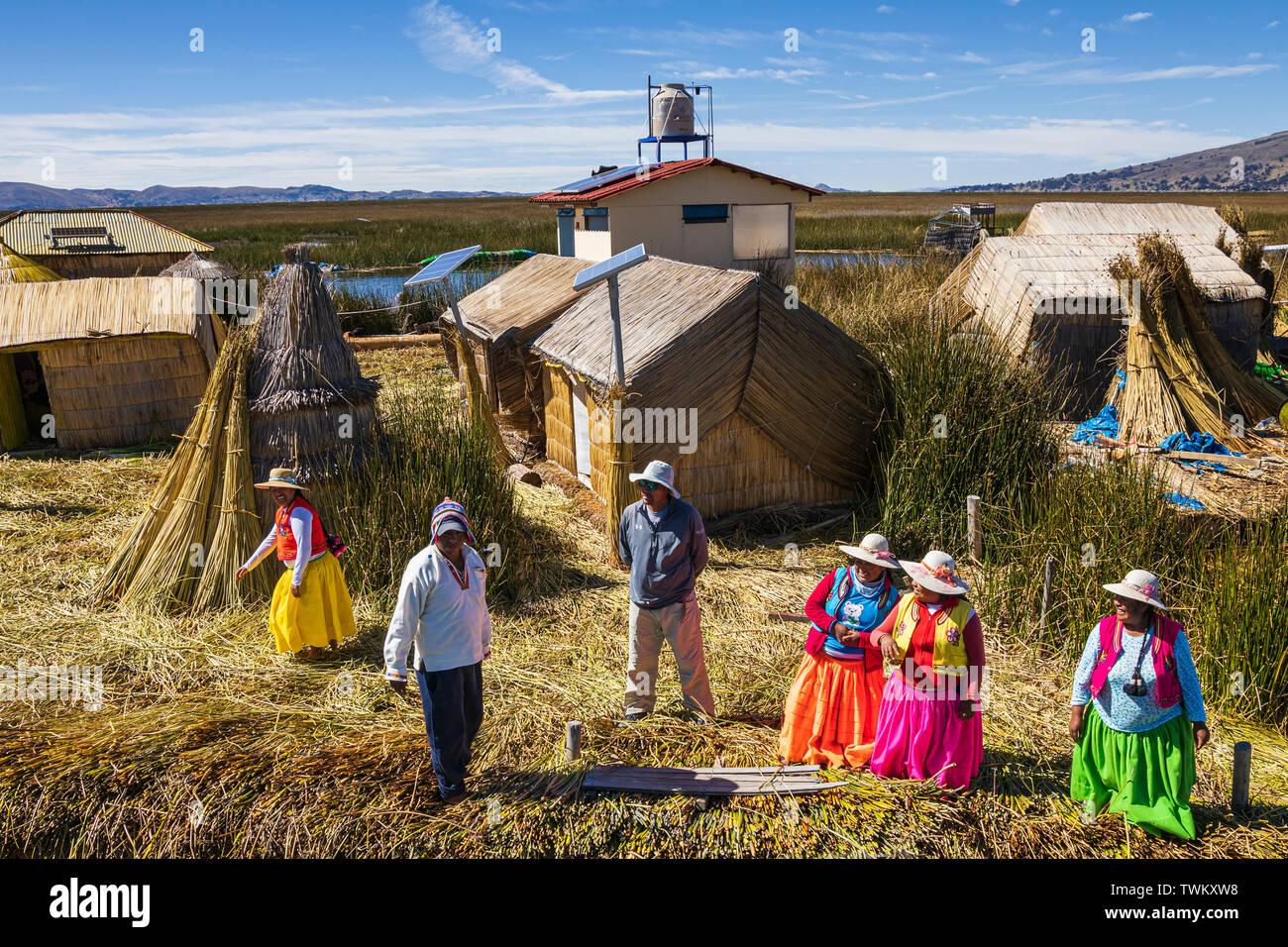 Islanders on Uros islands, reed floating islands on Lake Titicaca, Peru, South America - Stock Image