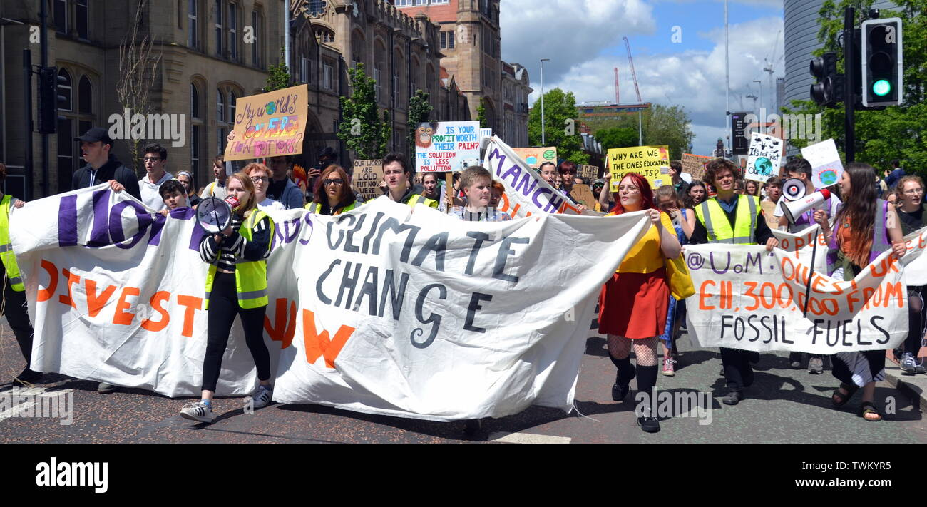 Young people lobby for action to prevent climate change at the  Manchester Youth Strike 4 Climate protest on June 21, 2019, in Manchester, uk. The group marched from St Peter's Square in the city centre to the University of Manchester. One of their demands is for the University to divest itself of investments in fossil fuels. - Stock Image
