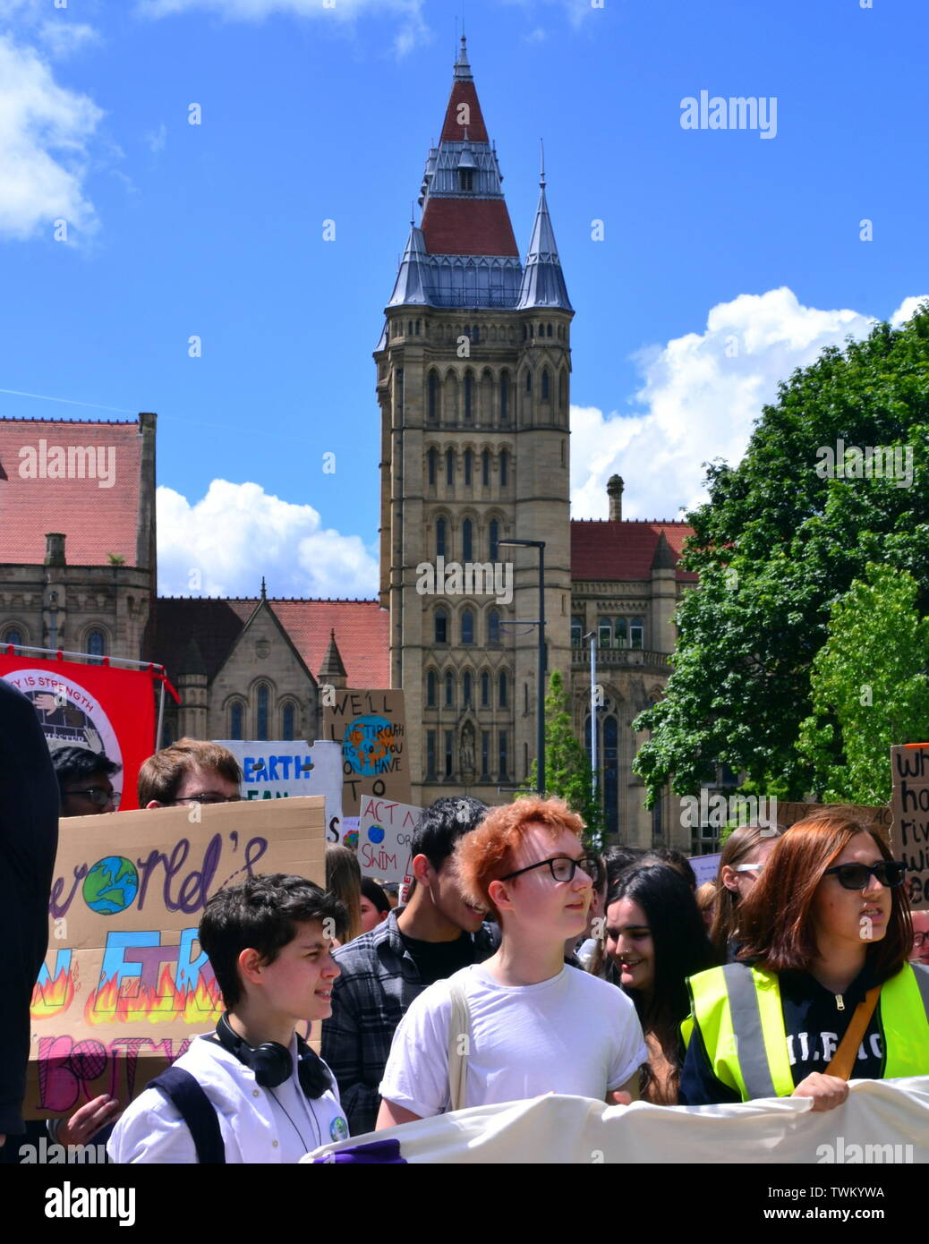 Young people lobby for action to prevent climate change at the  Manchester Youth Strike 4 Climate protest on June 21, 2019, in Manchester, uk. The group marched from St Peter's Square in the city centre to the University of Manchester. One of their demands is for the University to divest itself of investments in fossil fuels. The building behind the protesters is the University's Whitworth Hall. - Stock Image