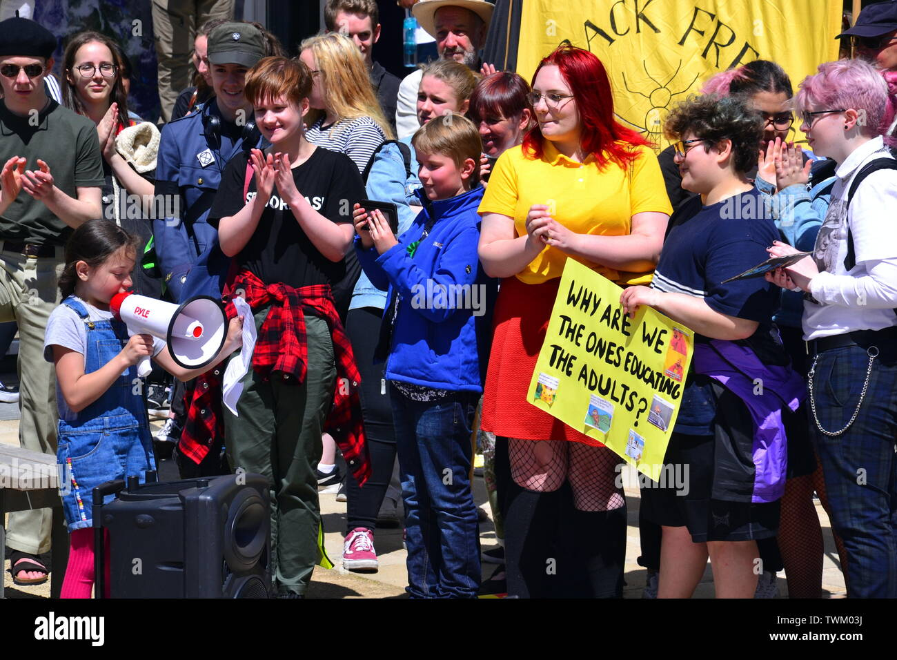 A young girl addresses young people lobbying for action to prevent climate change at the  Manchester Youth Strike 4 Climate protest on June 21, 2019, in Manchester, uk. The group marched from St Peter's Square in the city centre to the University of Manchester. One of their demands is for the University to divest itself of investments in fossil fuels. - Stock Image