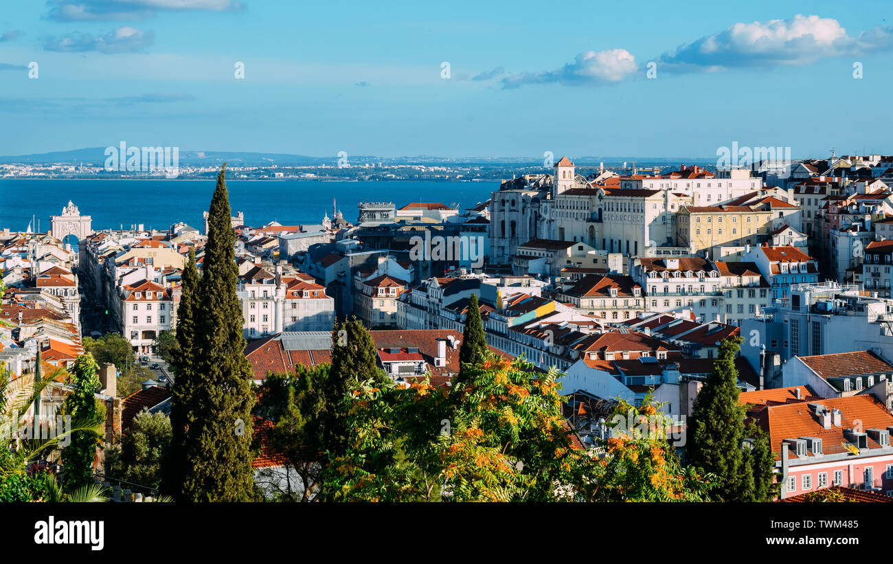 Lisbon, Portugal cityscape overlooking Baixa downtown area. Visible landmarks include: Rua Augusta Triumphal Arch, Rossio, Santa Justa Elevator Stock Photo