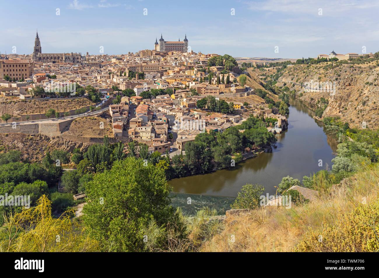 Toledo, Toledo Province, Castilla-La Mancha Spain.  Overall view of the historic centre showing the Tagus River (Rio Tajo) with the Alcazar centre and Stock Photo