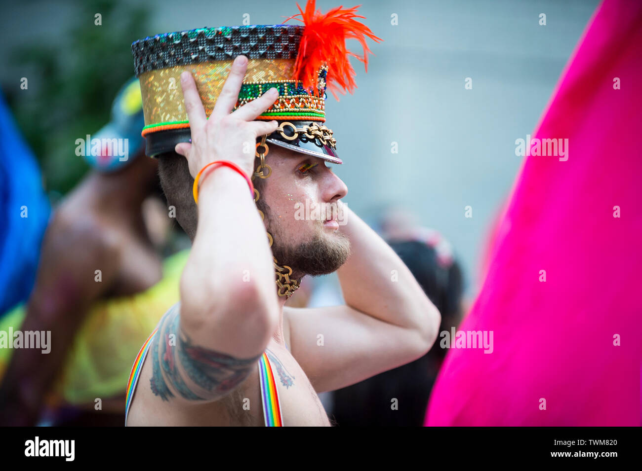 NEW YORK CITY - JUNE 25, 2017: A supporter wears a flamboyant beaded hat in the annual gay Pride Parade as it passes through Greenwich Village. - Stock Image