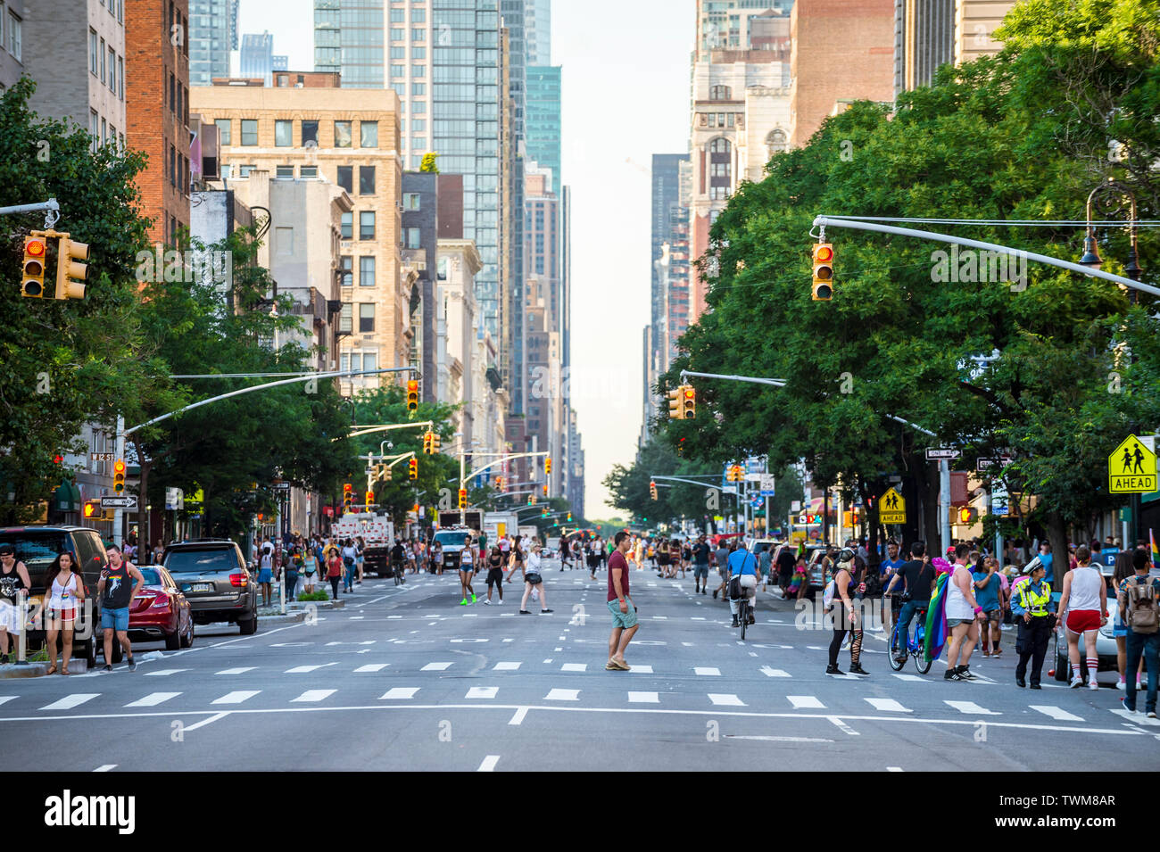 NEW YORK CITY - JUNE 25, 2017: The streets of Lower Manhattan are closed to traffic as supporters of the annual Gay Pride Parade flood downtown. - Stock Image