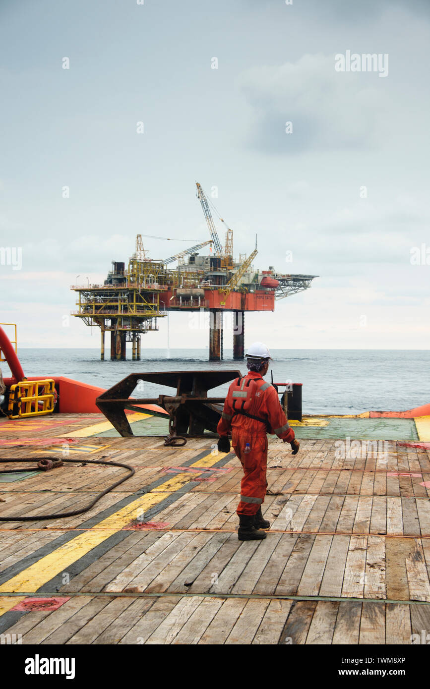 marine crew preparing anchor on deck  before deploy the anchor to sea Stock Photo