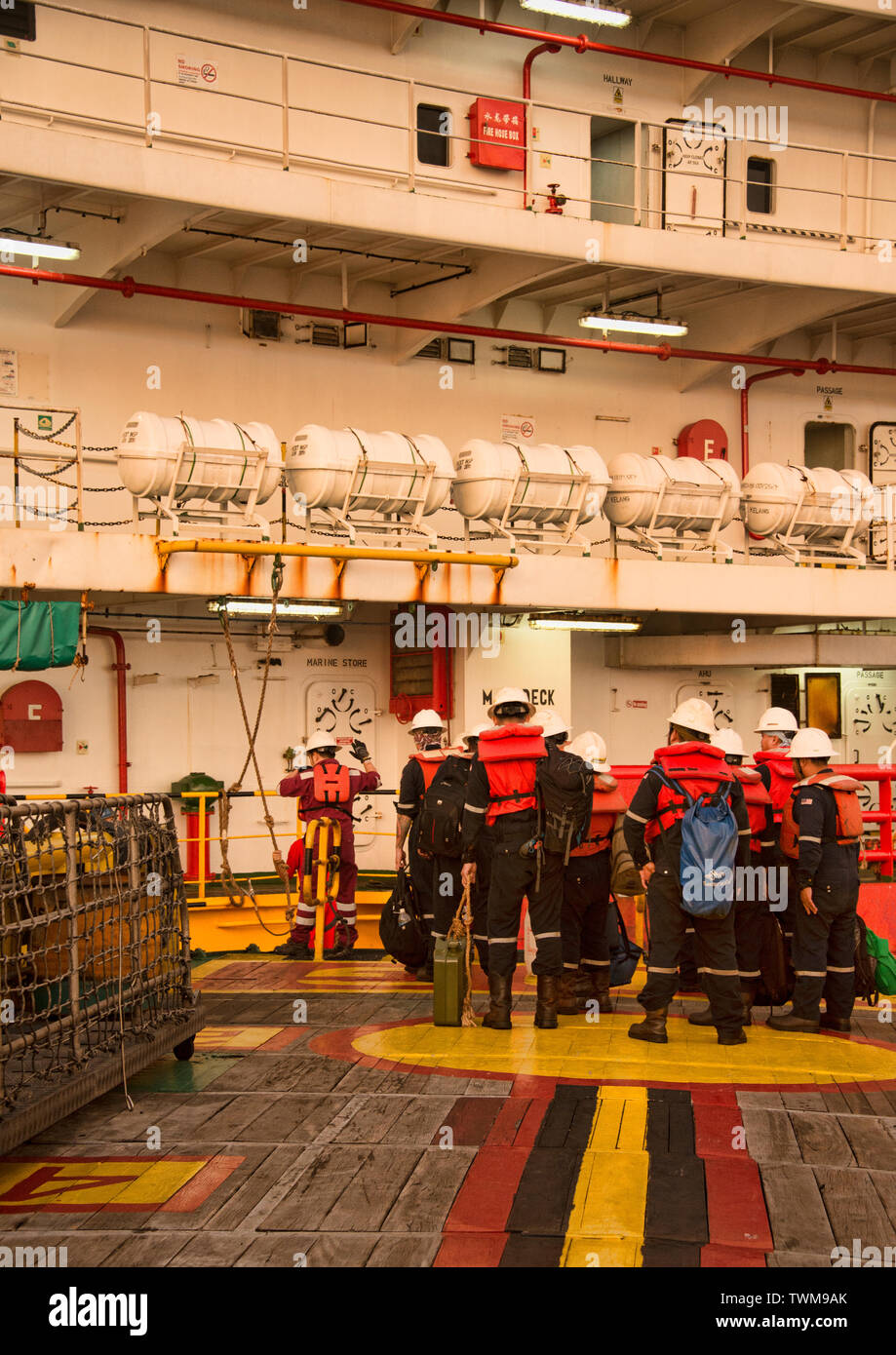 offshore worker get ready to boarding accommodation barge from other boat - Stock Image