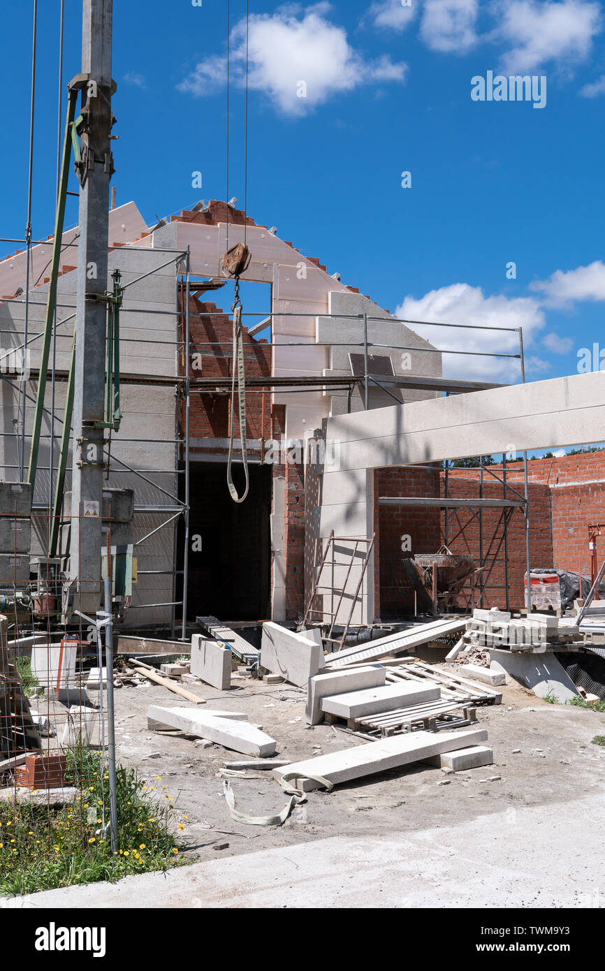 Construction site of an new built house with stone facade. Galicia, Spain - Stock Image
