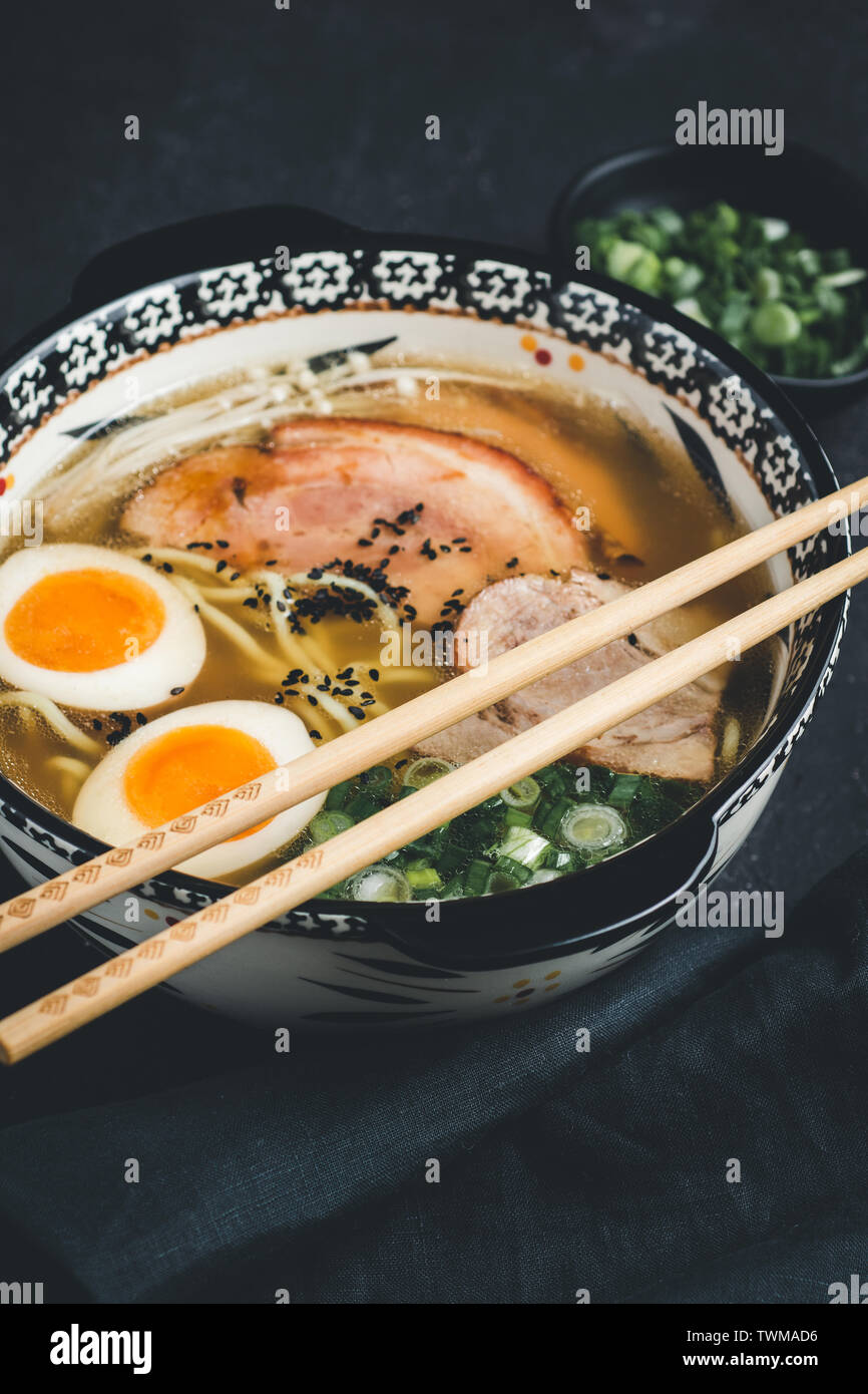 Ramen Soup with Udon Noodles, Pork and Eggs on Dark Background Stock Photo