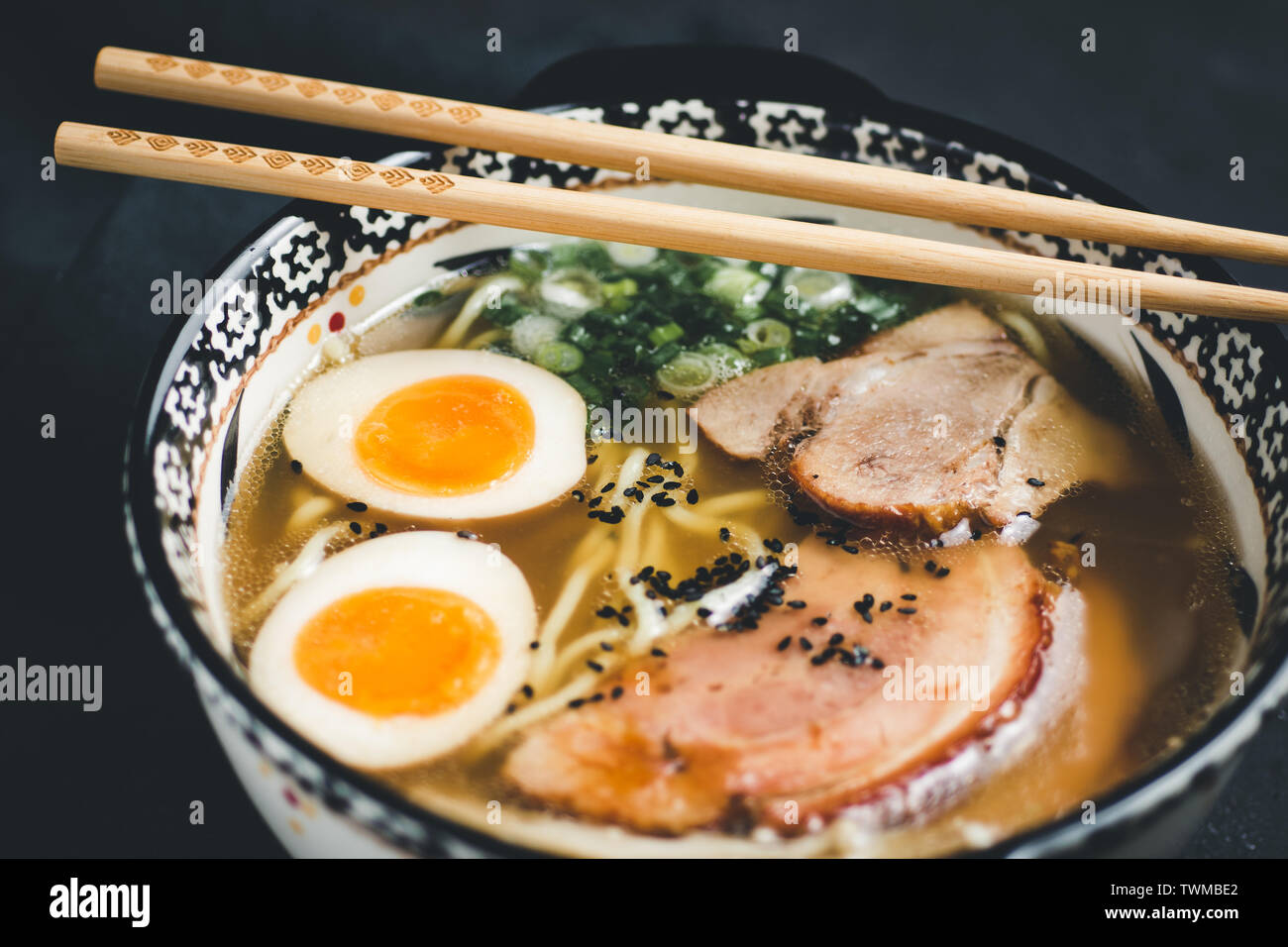 Traditional Ramen Soup with Udon Noodles, Pork and Eggs Stock Photo