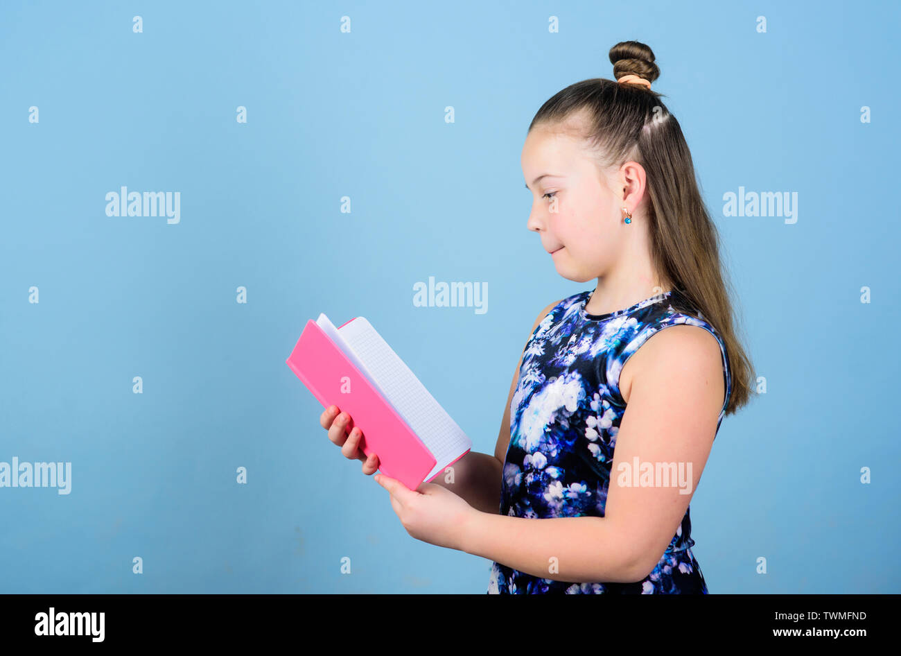 art director. workbooks for writing. school diaries for making notes. small girl with pink note book. school child with notepad. smart trendy kid read note folder. little business lady. small boss. - Stock Image