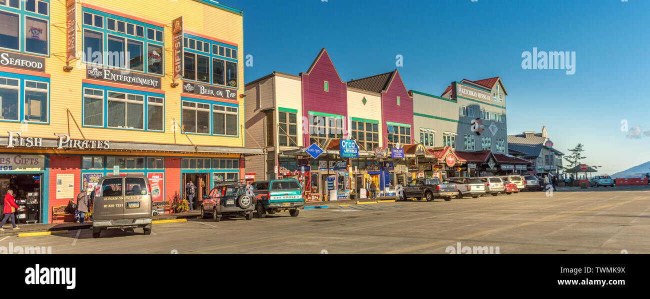 Sept. 17, 2018 - Ketchikan, AK: Shops and parked vehicles on Spruce Mill Way in warm late afternoon sunlight. Near closing time, with few people on st - Stock Image