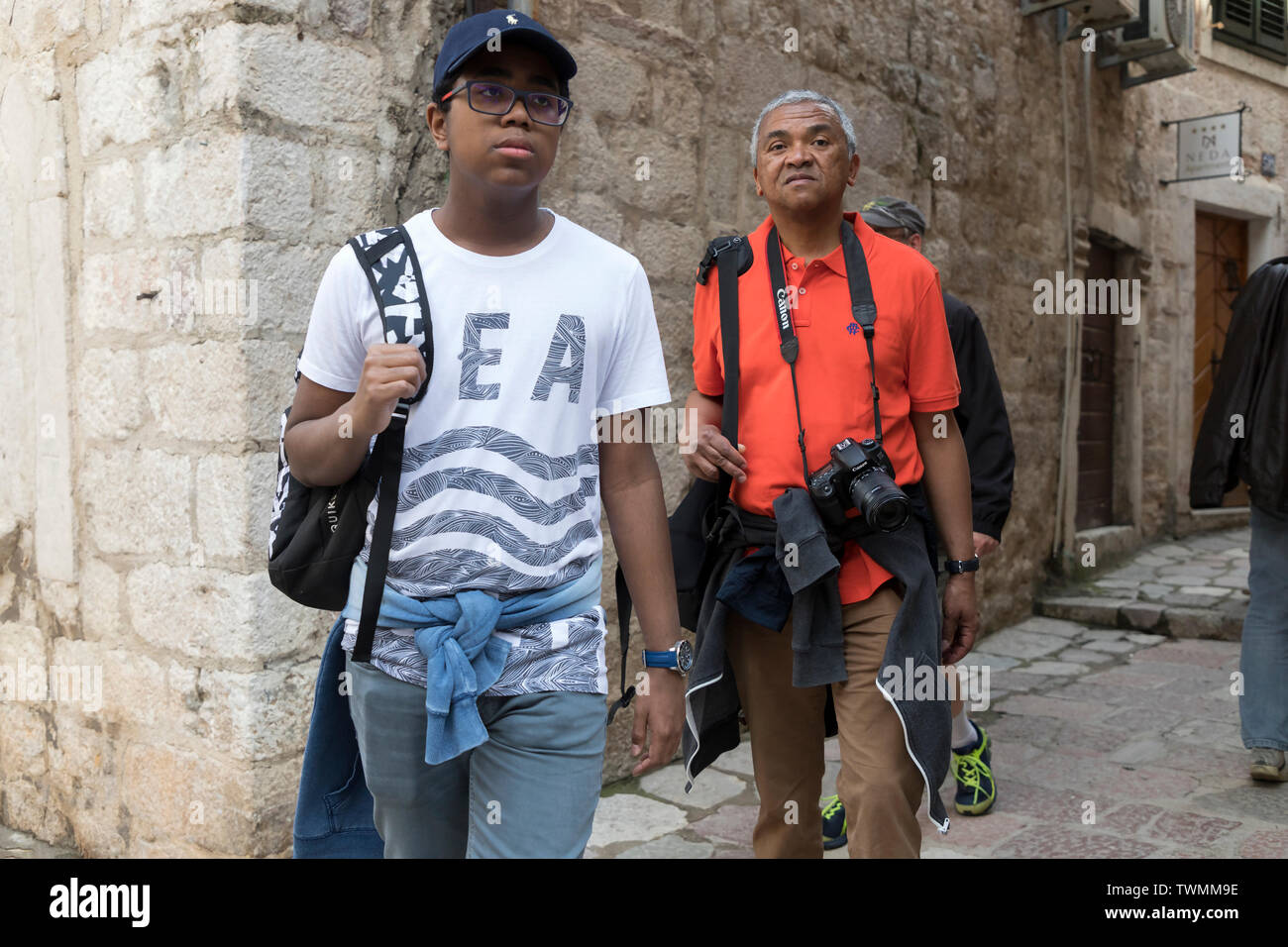 Montenegro, May 2nd 2019: Street photographer sightseeing of Kotor Old Town with teenage son - Stock Image