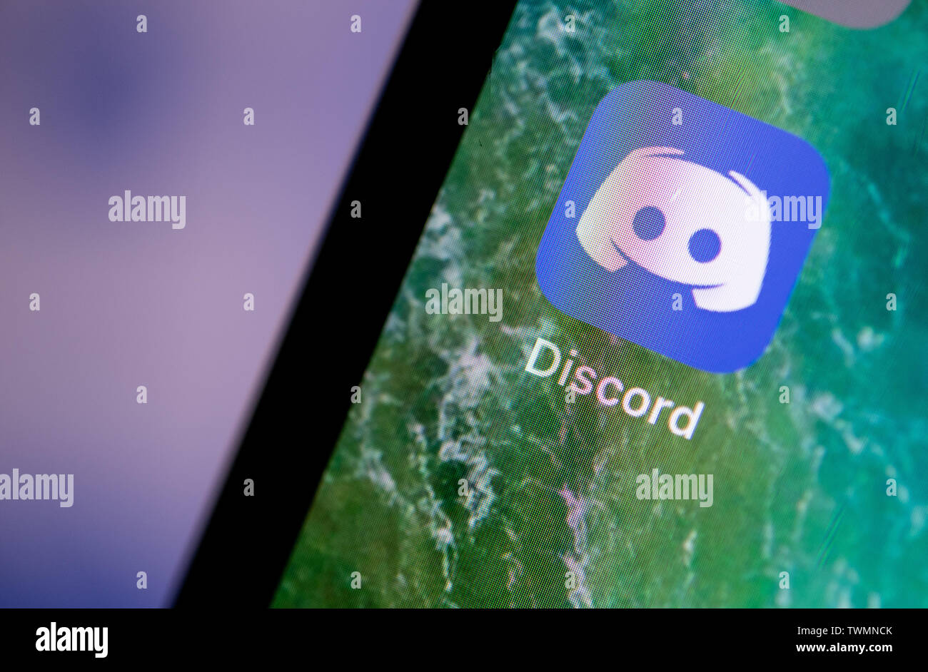 Stuttgart, Germany. 21st June, 2019. The Discord app is displayed on the screen of an iPhone. Credit: Fabian Sommer/dpa/Alamy Live News - Stock Image