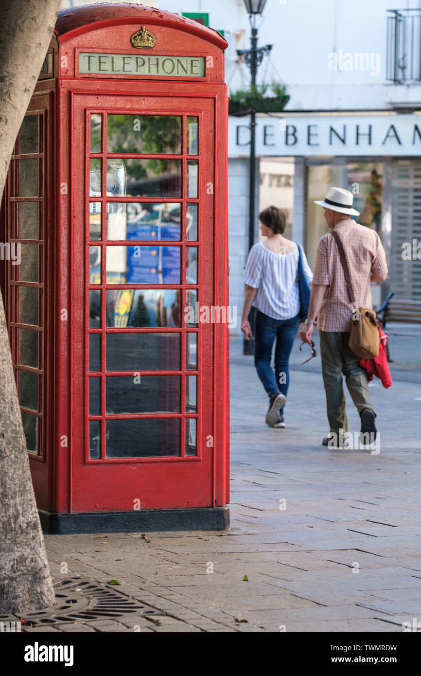 Telephone boxes designed in UK by Sir Giles Gilbert Scott still in use in Gibraltar where they are a tourist attraction with British connection - Stock Image