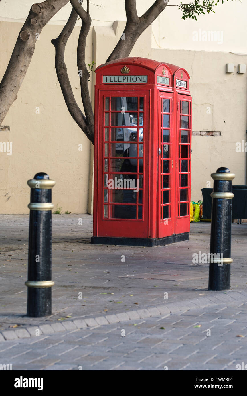 Telephone boxes designed in UK by Sir Giles Gilbert Scott still in use in Gibraltar where they are a tourist attraction indicating the British connect. - Stock Image
