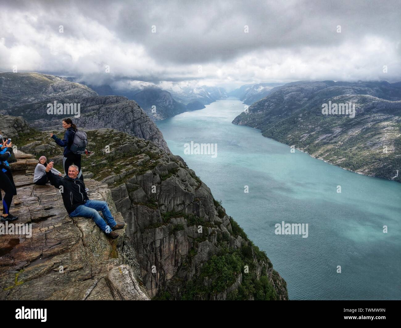 Preikestolen, Norway. 21st June, 2019. A man takes a selfie with the Lysefjord in the background while at Norway's Preikestolen (Pulpit Rock) Credit: Sachelle Babbar/ZUMA Wire/Alamy Live News - Stock Image