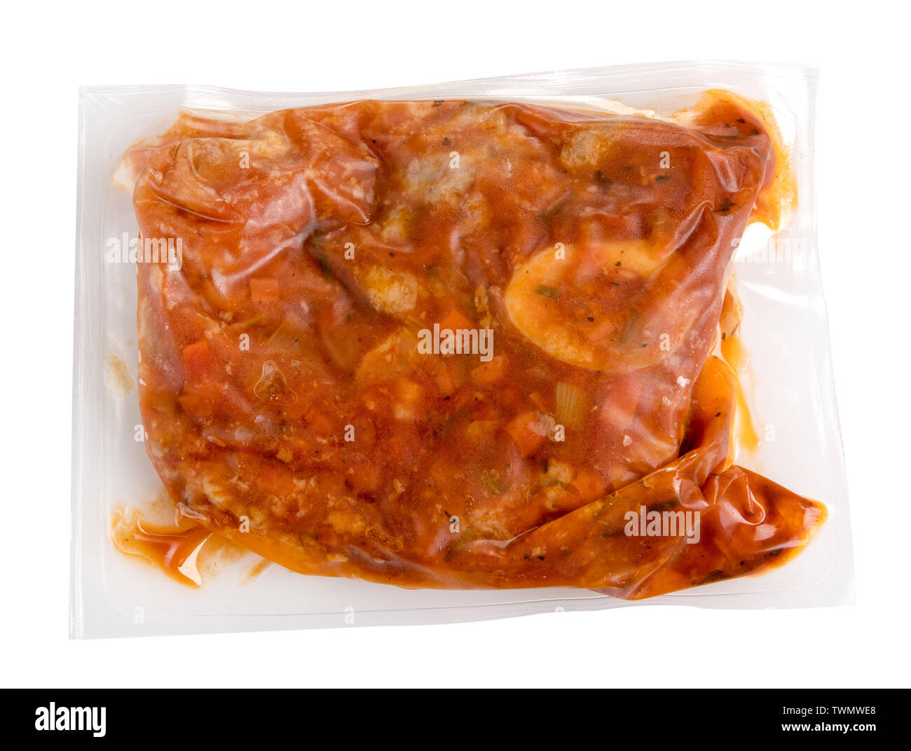 Vacuum packed meal of prepared ossobucco with veal in a wine and fruit sauce in an air-tight plastic bag for freezing or to extend shelf life - Stock Image