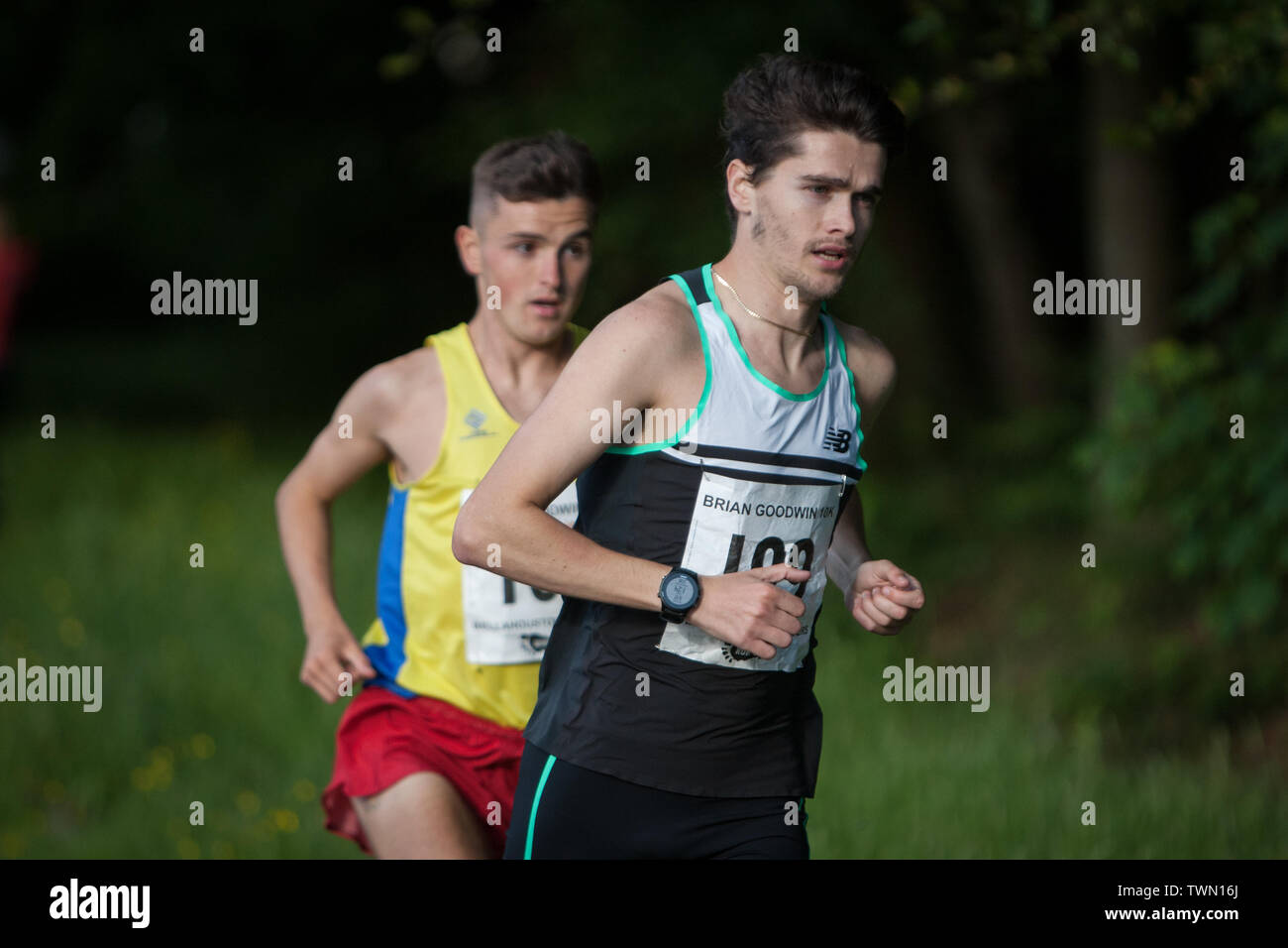 Glasgow, Scotland. 21st June, 2019. The Brian Goodwin Memorial 10km road race, hosted by Bellahouston Harriers running club, and held in Glasgow's scenic Pollok Country Park, was tonight won by Olympian Callum Hawkins in a time of 29minutes 06secs. (Hawkins wears Bib 199, Kilbarchan AAC); 2nd male was Jamie Crow (Bib 108, Central AC)) with a Personal Best time of 29min 43sec, and 3rd male was James Donald (30:11, Bib 130, Dundee Hawkhill Harriers).  Credit: jeremy sutton-hibbert/Alamy Live News Stock Photo