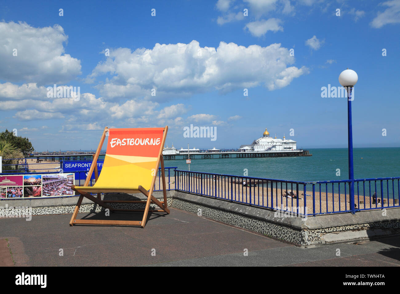 Deckchair on Eastbourne seafront promenade , East Sussex, UK - Stock Image